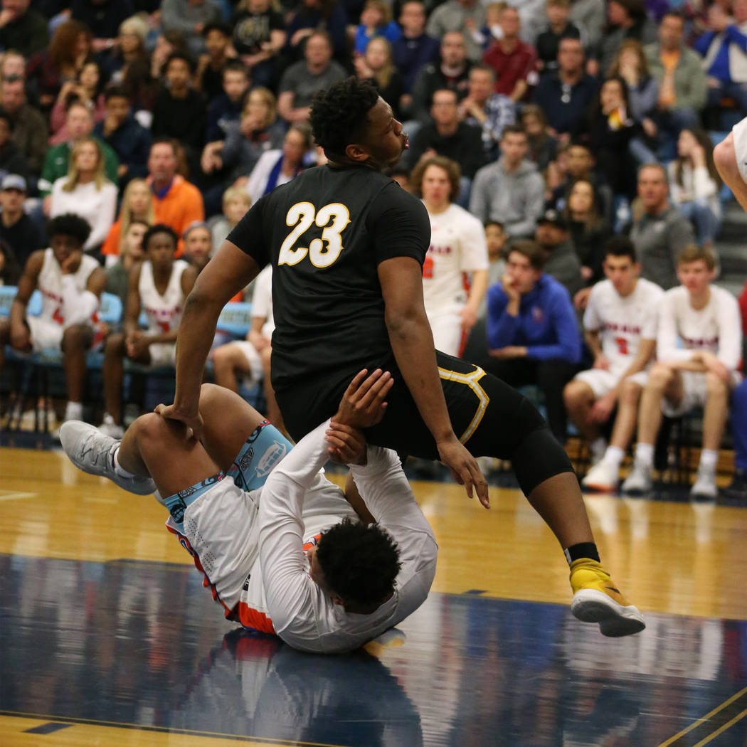 Clark's Antwon Jackson (23) falls over Bishop Gorman's Max Allen (12) in the Des ...