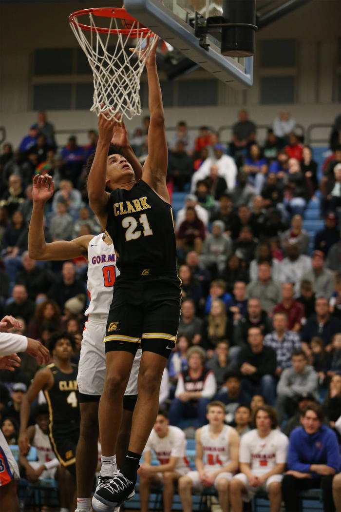Clark's Jalen Hill (21) goes up for a shot against Bishop Gorman in the Desert Region ...