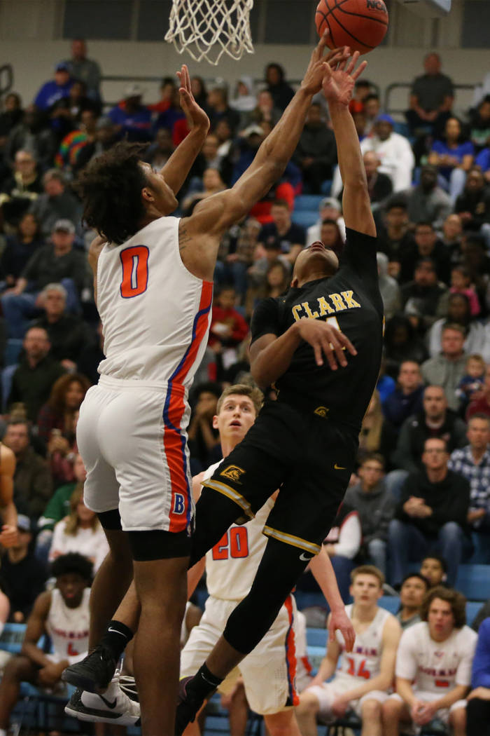 Clark's Frankie Collins(1) gets his shot blocked by Bishop Gorman's Isaiah Cottr ...