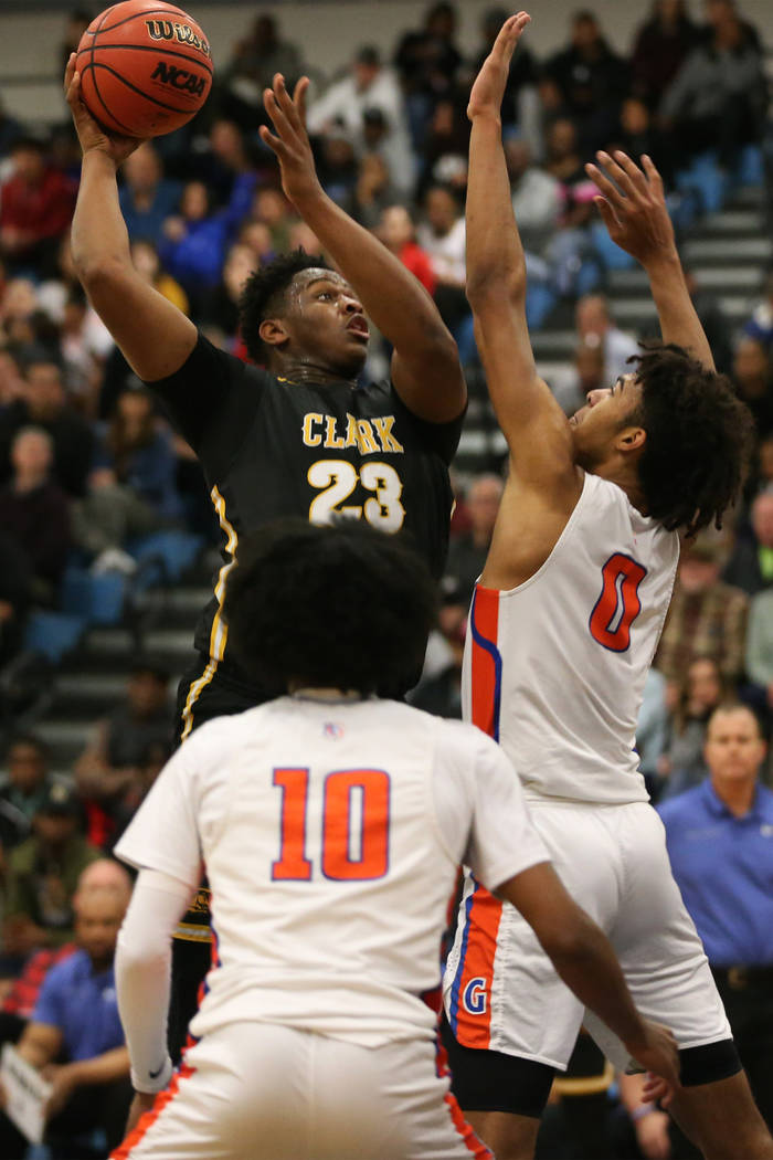 Clark's Antwon Jackson (23) goes up for a shot against Bishop Gorman's Isaiah Co ...