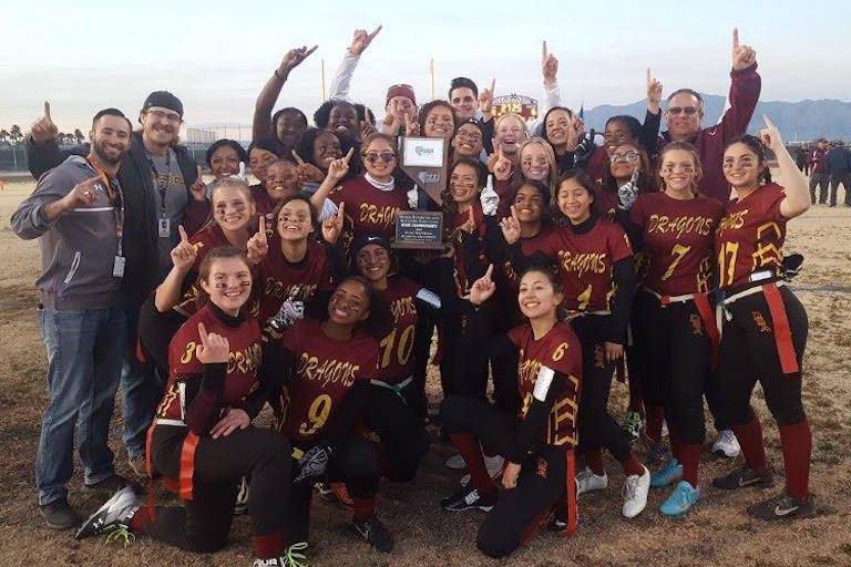 Del Sol poses with the Class 3A state championship trophy after defeating Virgin Valley, 19- ...