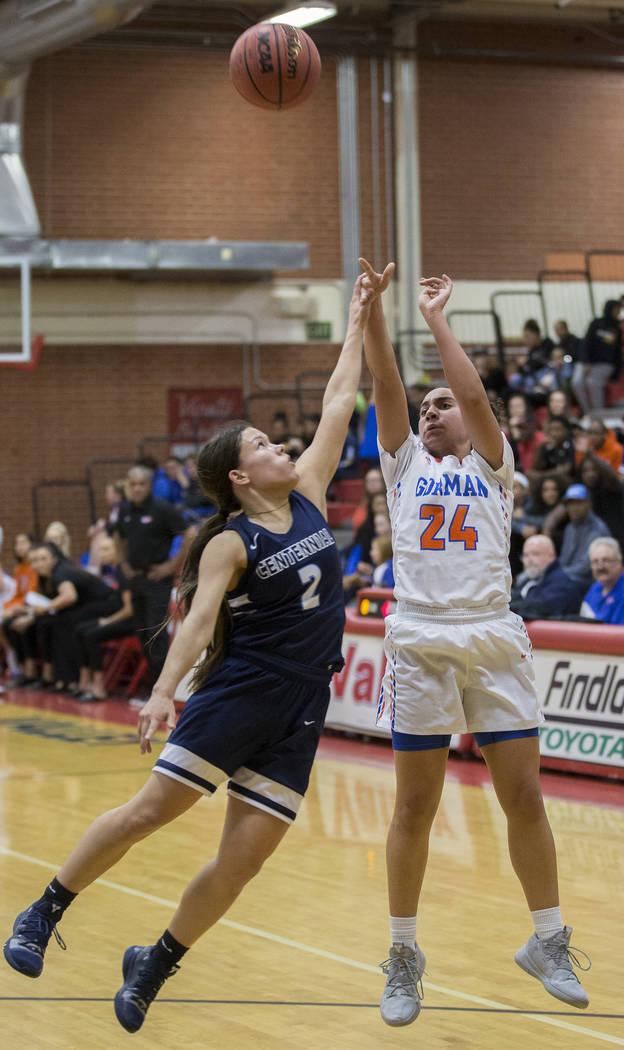 Bishop Gorman junior Bentleigh Hoskins (24) shoots a three point shot over Centennial senior ...