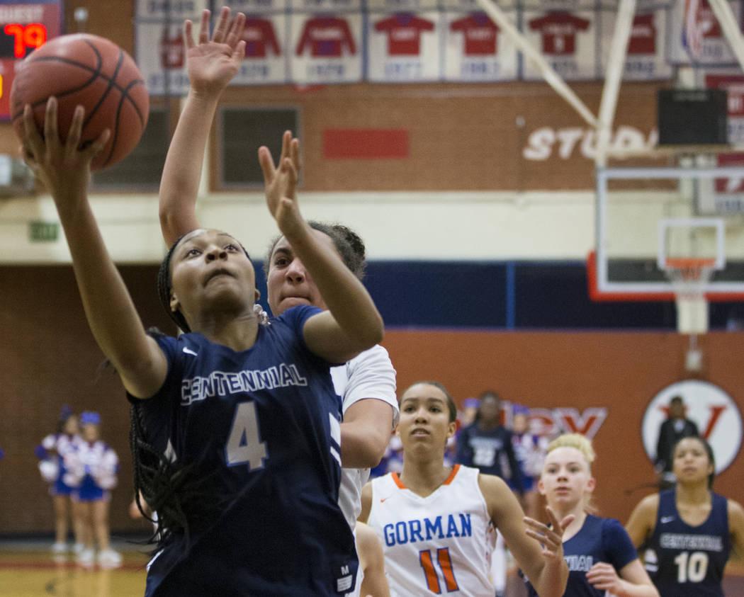 Centennial sophomore Taylor Bigby (4) drives past Bishop Gorman senior Olivia Smith (11) in ...