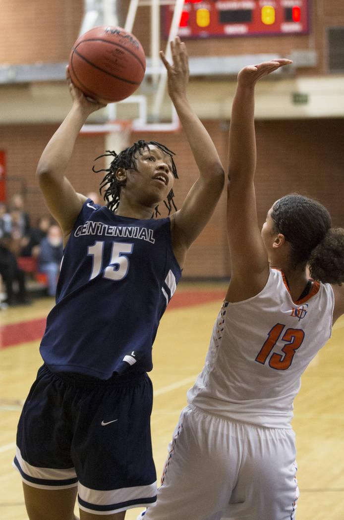 Centennial junior Daejah Phillips (15) shoots over Bishop Gorman senior Georgia Ohiaeri (13) ...