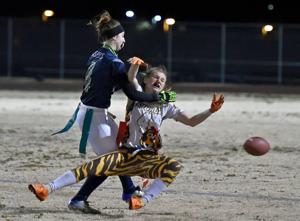 Green Valley's Hailee McKay, left, is called for pass interference against Bonanza&#82 ...