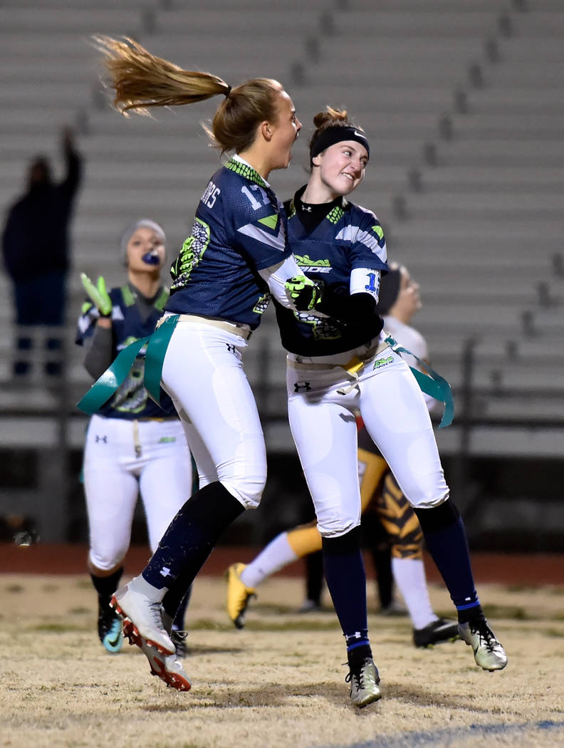 Green Valley's Nicolette De La Carrera (17) and Hailee McKay celebrate after the team ...