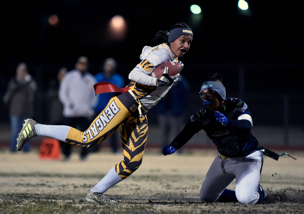 Bonanza's Ashley Vasquez (75) avoids a tackle from Green Valley's Anna Marie Arc ...