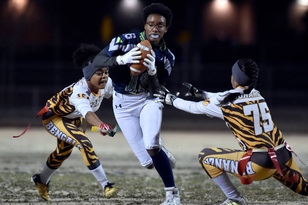 Green Valley's Deborah Grant (16) carries the ball against Bonanza during Class 4A sta ...