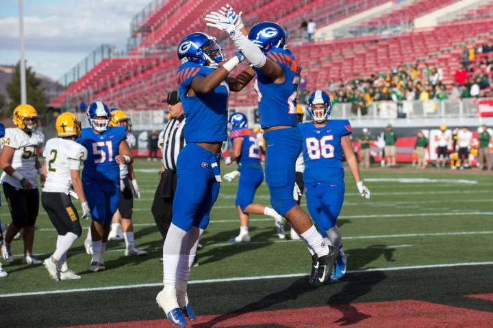 Bishop Gorman running back Amod Cianelli (23), right, celebrates his touchdown with Donovan ...