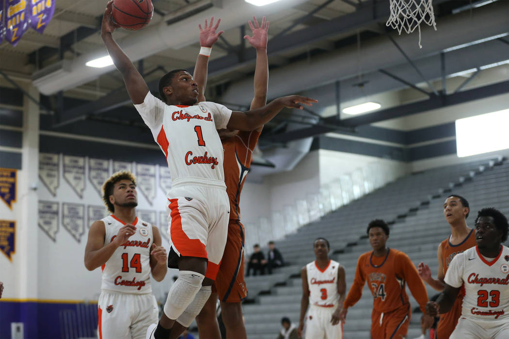 Chaparral's Meshach Hawkins (1) goes up for a shot against Legacy in the boy's b ...
