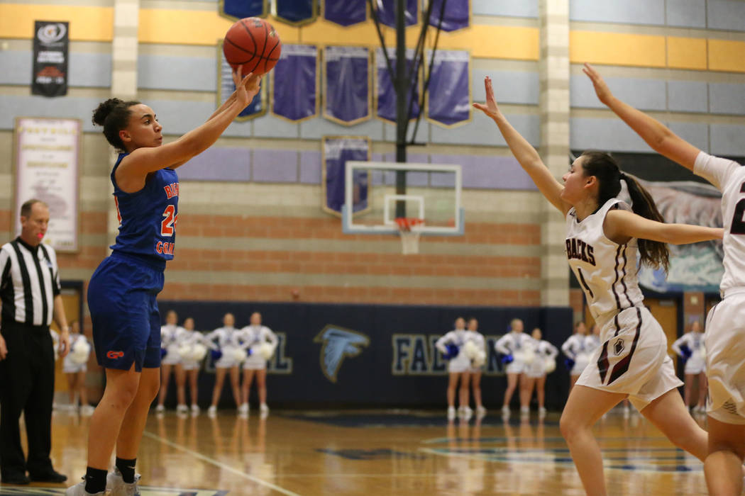 Bishop Gorman's Bentleigh Hoskins (24) shoots a three-point-shot for a score against D ...