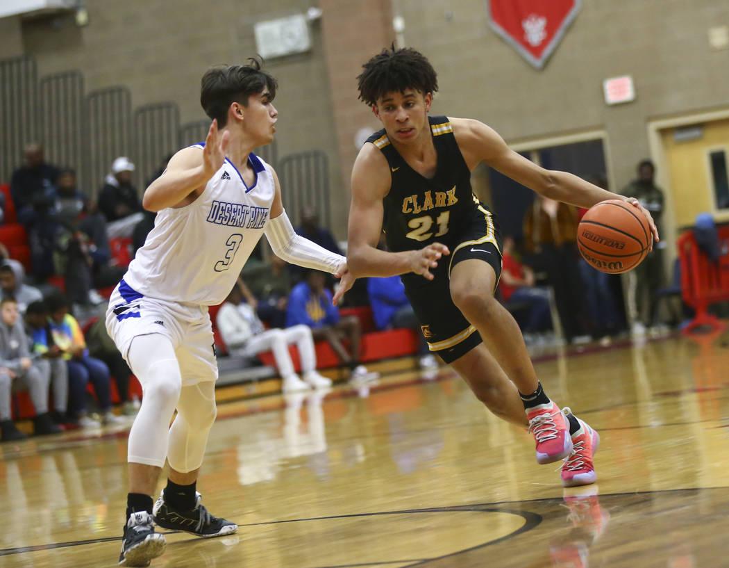 Clark's Jalen Hill (21) moves the ball around Desert Pines' Cimarron Conriquez ( ...