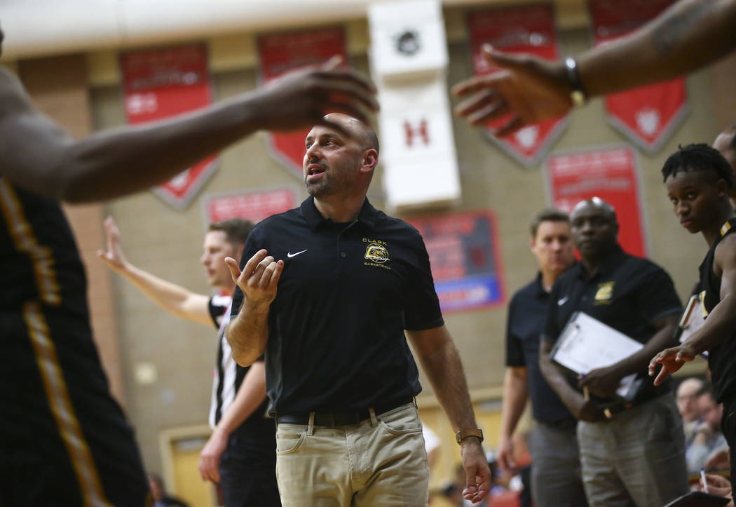 Clark head coach Chad Beeten motions to his team during the first half of a Class 4A state b ...