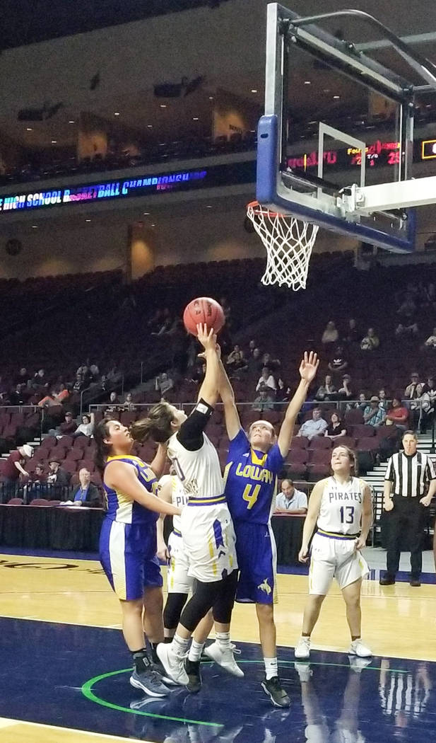 Moapa Valley's Peyton Schraft shoots over Lowry's Rebecca Kuskie in the Class 3A ...