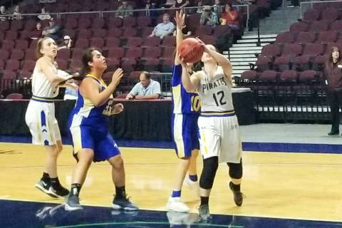 Moapa Valley's Lainey Cornwall scores a basket in the second half against Lowry in the ...