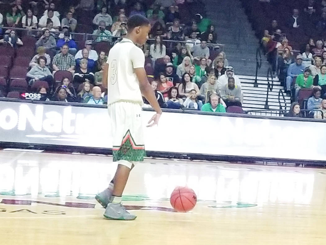 Mojave's Dante Ingram brings the ball down the floor in the Class 3A state semifinals ...
