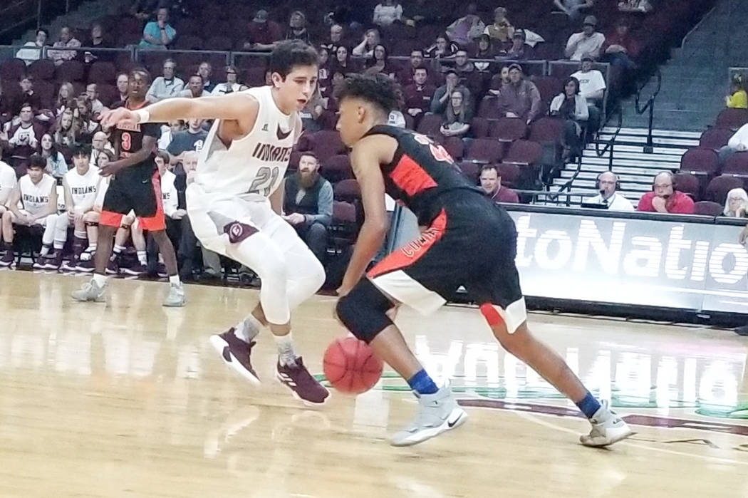 Chaparral's Sameal Anderson makes a move on Elko's Alex Klekas in the Class 3A s ...