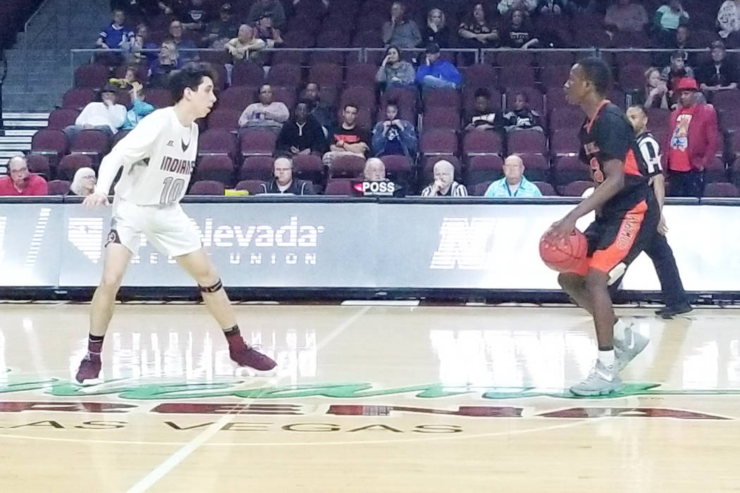 Chaparral's Elijah Briggs, right, is guarded by Elko's Sean Klekas in the Class ...