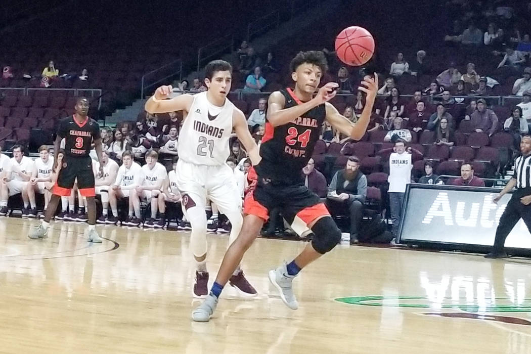 Chaparral's Sameal Anderson grabs a loose ball as Elko's Alex Klekas defends in ...