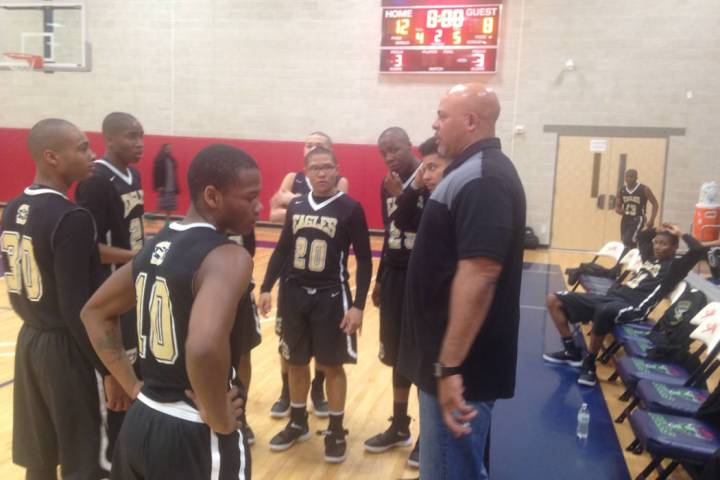 Spring Mountain coach Asad Ali talks to his team after the first quarter of the Golden Eagle ...