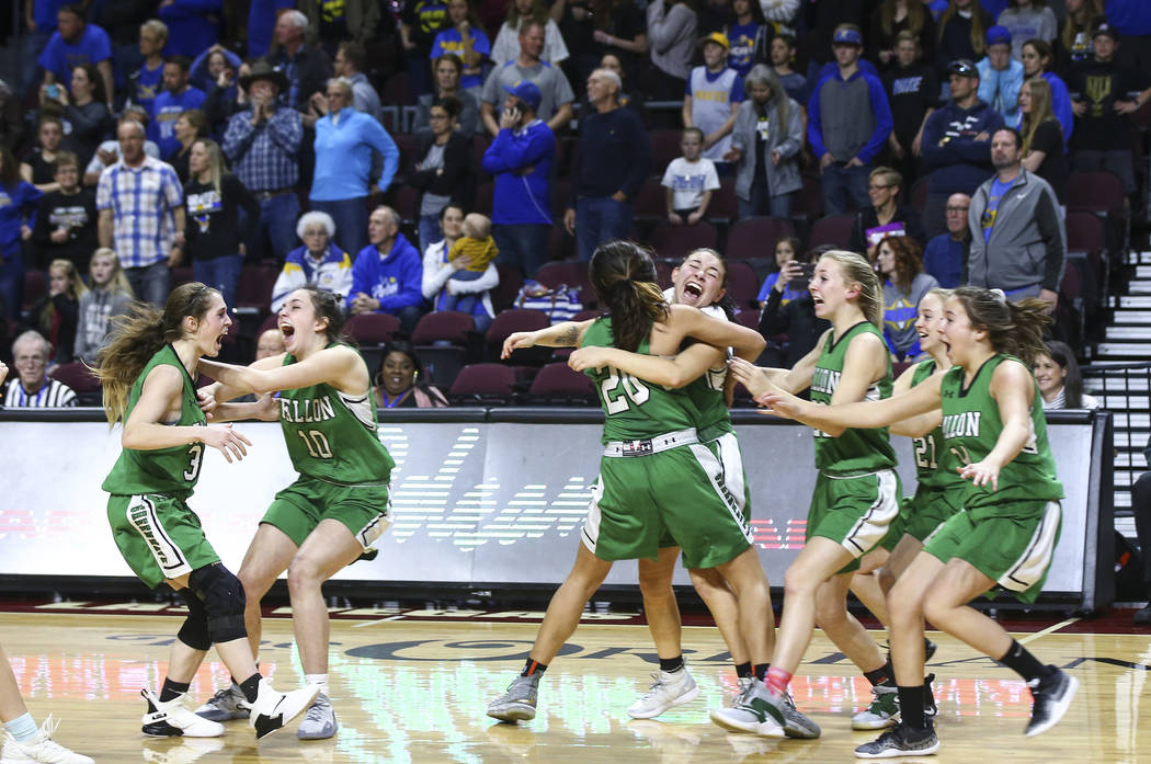 Churchill County players celebrate their win against Moapa Valley in the Class 3A girls bask ...