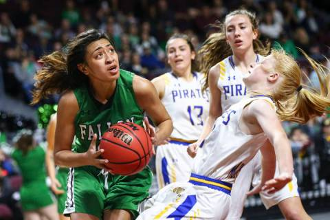Churchill County's Leilani Otuafi goes to the basket against Moapa Valley's Kait ...