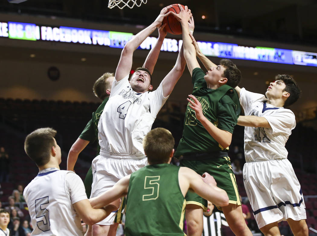 The Meadows forward Joe Epstein (4) reaches out for a rebound against Incline guard Brody Th ...