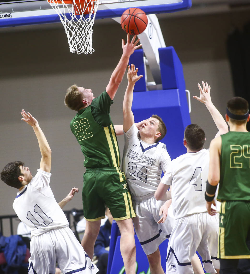 Incline guard Liam Nolan-Bowers (22) shoots over The Meadows guard Allen Fridman (24) during ...