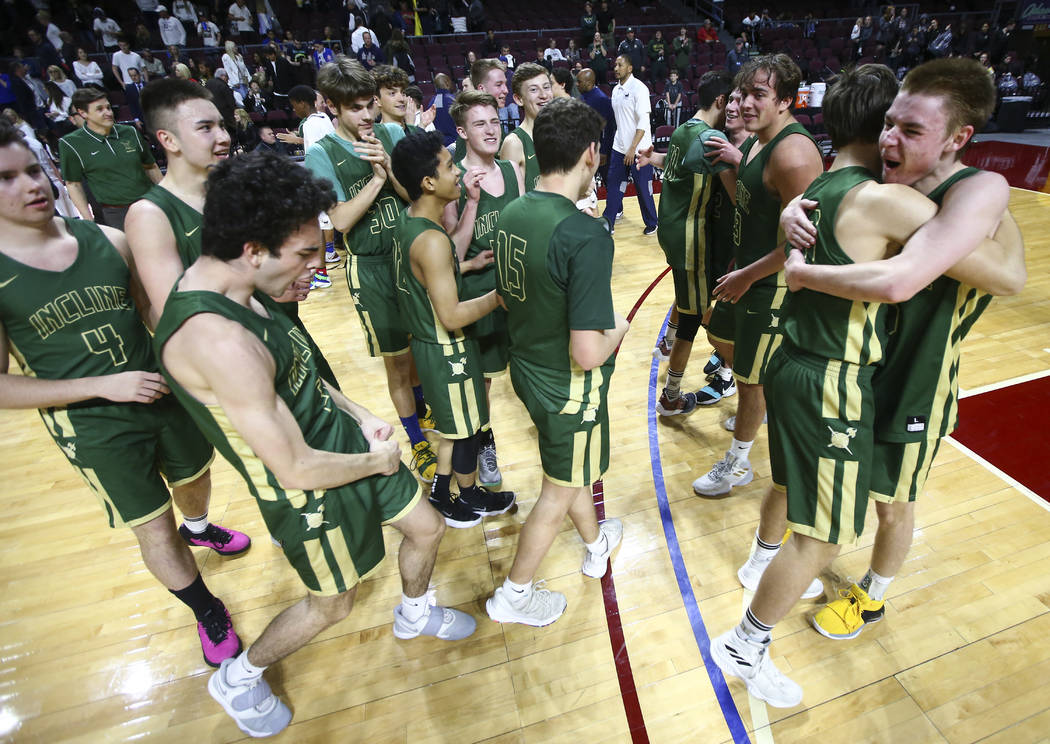 Incline players celebrate their win over The Meadows in the Class 2A boys basketball state c ...