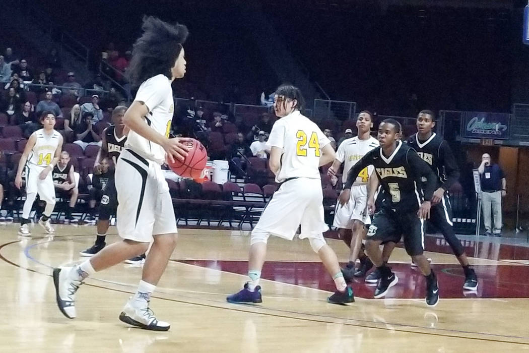 Mineal County's Robert McFalls looks to drive against Spring Mountain in the Class 1A ...