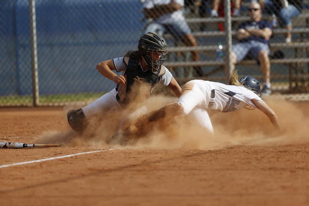Shadow Ridge's catcher Caitlyn Covington (3) tags Centennial's Seanna Simpson (5 ...