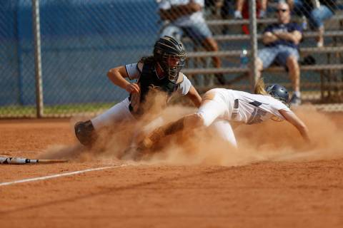 Shadow Ridge's catcher Caitlyn Covington (3) tags Centennial's Seanna Simpson (5 ...