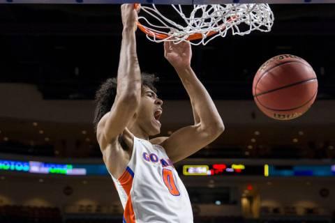 Bishop Gorman junior forward Isaiah Cottrell (0) converts a fast-break dunk in the fourth qu ...