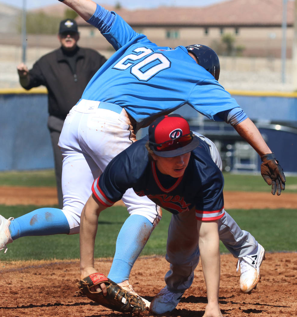 Centennial's Travis Rice (20) and Liberty's Ethan Safier collide at second durin ...