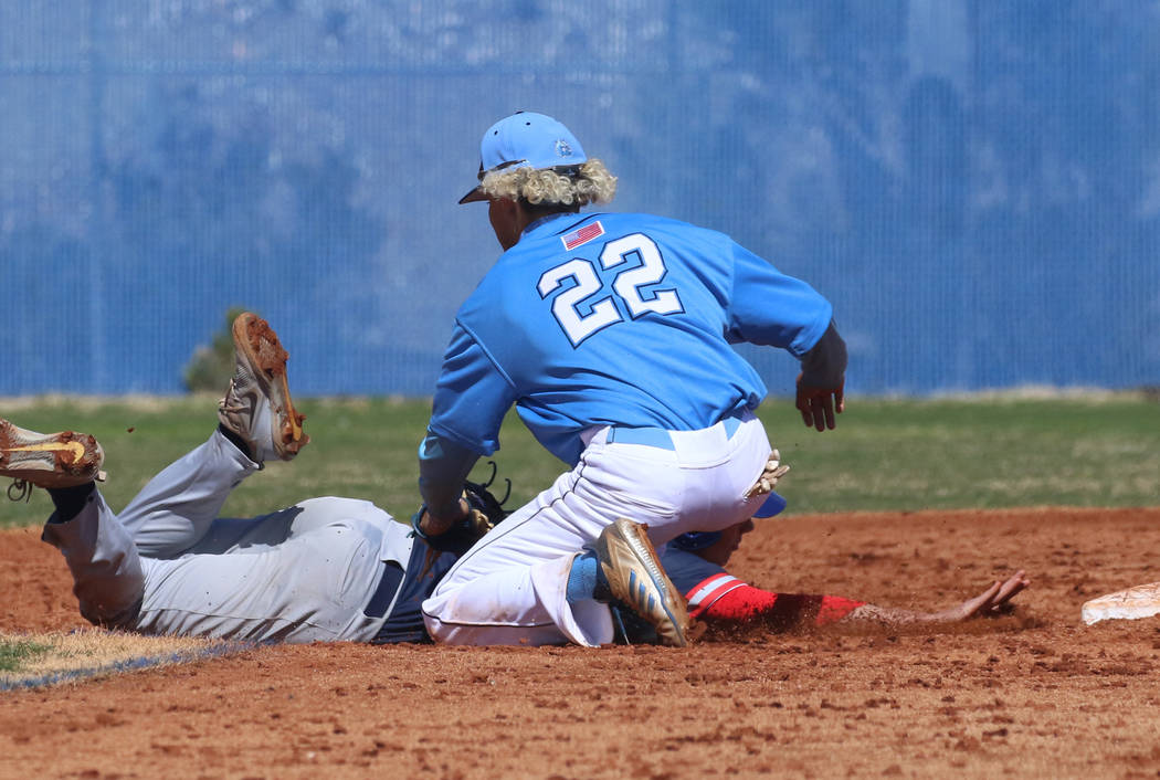 Centennial's shortstop Rene Almarez (22) tags Liberty's Chase Galleps at second ...