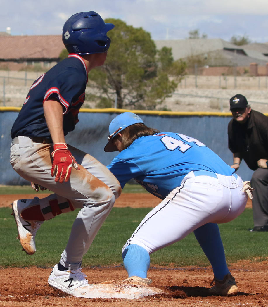 Centennial's third baseman Kris Bow (44) tags Liberty's Jack Hale during their b ...