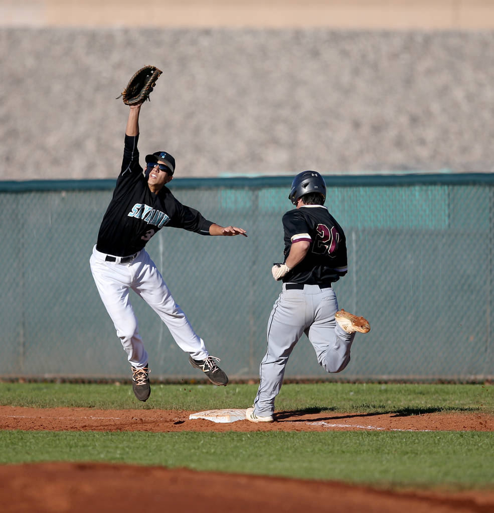 Faith Lutheran Dylan Howell (20) crosses first base as Silverado first baseman Jarod Hill (3 ...