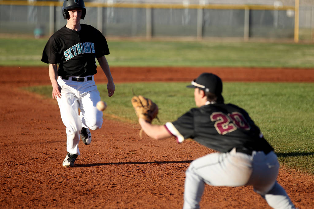 Faith Lutheran third baseman Dylan Howell (20) prepares to tag out Silverado baserunner Andr ...