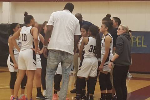 Calvary Chapel coach Shay Johnson speaks to his team during the fourth quarter of the Class ...