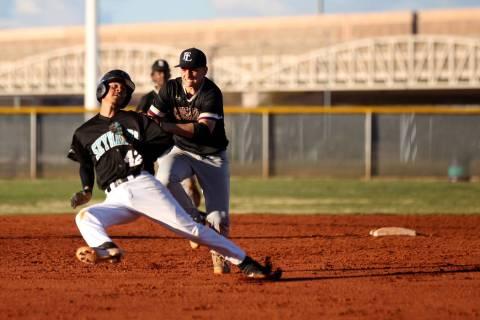 Faith Lutheran shortstop Parker Sylvester (5) tags out Silverado baserunner Caleb Hubbard (4 ...