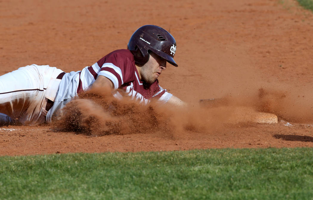 Cimarron-Memorial baserunner Lawrence Campa (15) slides safely into third base in the third ...