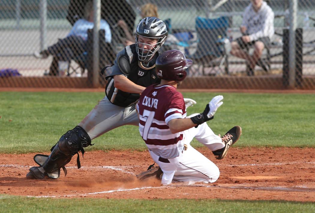 Silverado catcher Brant Hunt (18) tags out Cimarron-Memorial Zach Culver (7) at home in the ...