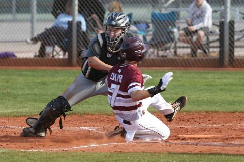 Silverado catcher Brant Hunt (18) tags out Cimarron-Memorial Zach Culver (7) at home in the ...