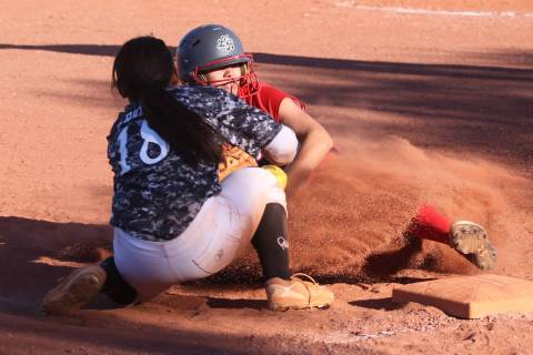 Liberty's Jessica Meza (20) slides safe for a triple against Desert Oasis' Jaid ...