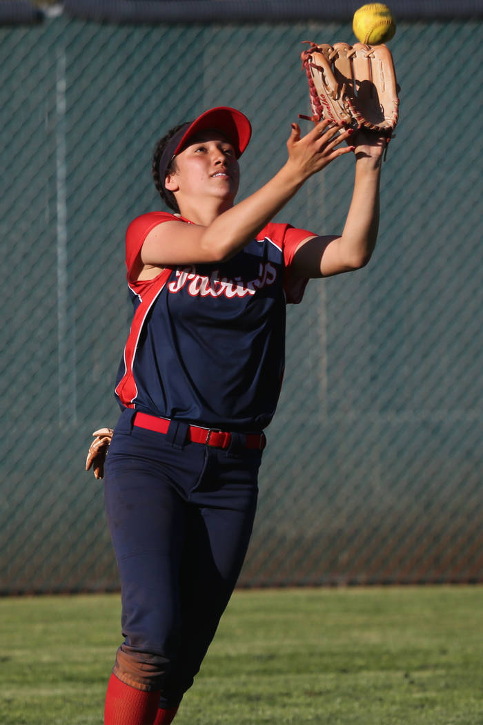 Liberty's Shelby Carvalho (13) makes a catch in the outfield against Desert Oasis in t ...