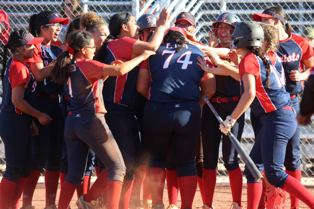 Liberty's Fia Tofi (74) celebrates a two-run homer with her team in the softball game ...