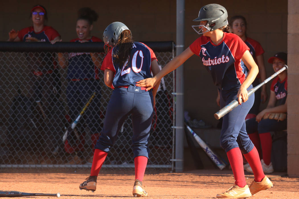 Liberty's Jessica Meza (20), left, celebrates her run with Shelby Carvalho (13) in the ...