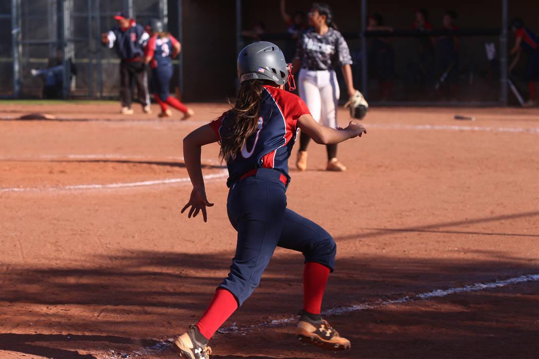 Liberty's Jessica Meza (20) runs home for a run against Desert Oasis in the softball g ...
