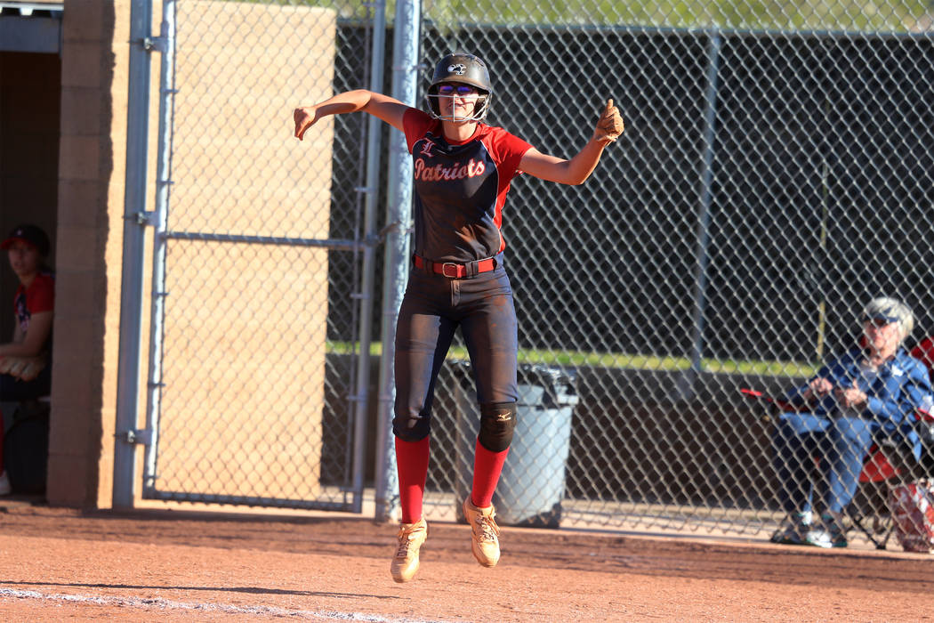 Liberty's McKenzie LaNeve (42) celebrates a run by her team in the sixth inning agains ...