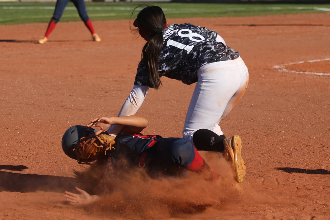 Desert Oasis' Jaid Riana Raval (18) tags out Liberty's Rebecca Warren (1) at thi ...